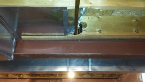 Large holes drilled through joists in basement.