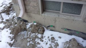 Ripped/Torn waterproofing material around the home.